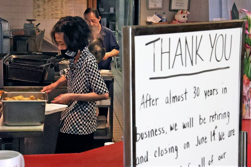 Mark Pi Express owners Kim Hua and his wife Tule cook for the lunch crowd at their restaurant in the Upper Valley Mall. Kim and Tule have owned the restaurant for 28 years and plan to retire when the mall closes on Monday. BILL LACKEY/STAFF