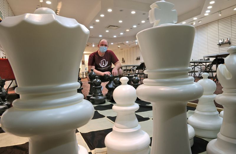 Daryl Skinner had just moved his business, the Springfield Chess Club, to a larger location in the Upper Valley Mall when he found out they were closing on June 14. BILL LACKEY/STAFF