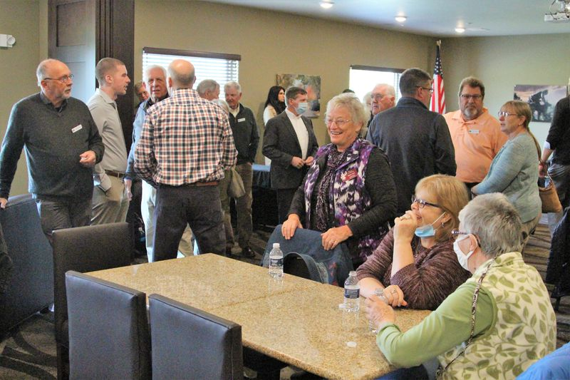 People gather at the Cobblestone Hotel in Urbana on Thursday to celebrate an official grand opening and ceremonial ribbon cutting. Hasan Karim/Staff